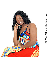 Woman sitting in colorful dress.