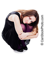 Woman sitting in dress and violet pantyhose