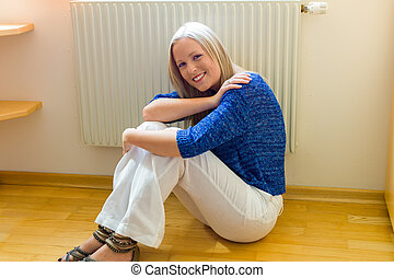 woman sitting in front of a radiator