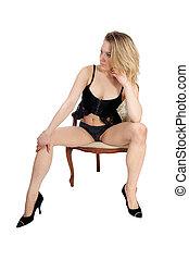 Woman sitting in lingerie.