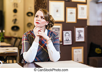 Woman sitting in the cafe alone