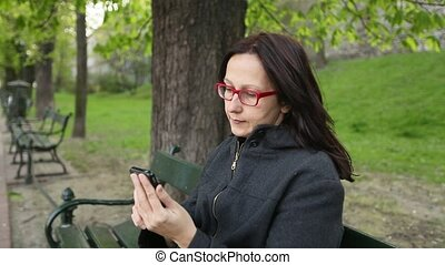 Woman sitting in the Park talking
