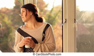Woman sitting in window