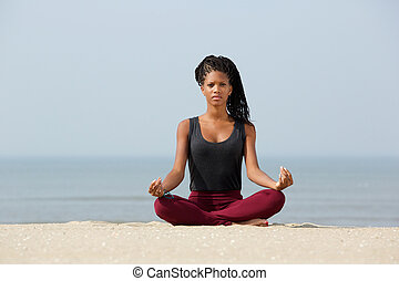 Woman sitting in yoga lotus pose