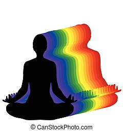 Woman sitting in yoga lotus position with aura