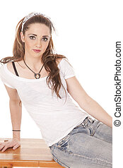 Woman sitting leaning to side