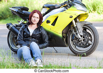 woman sitting near bike