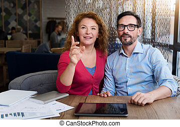 Woman sitting near her partner and pointing forward