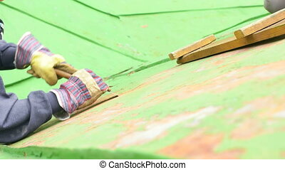 Woman Sitting Next to the Ladder, Scraping Paint - Worker...