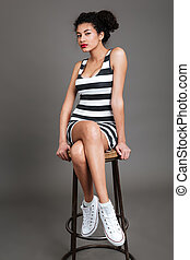 Woman sitting on a chair and looking at camera