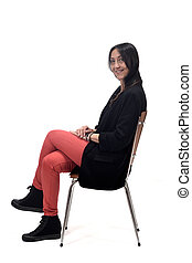 woman sitting on a chair isolated on white