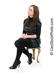 woman sitting on a chair isolated over a white background