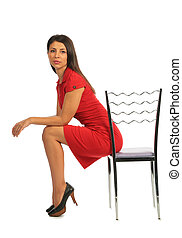 Woman sitting on a chair, profile