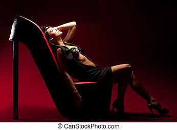 woman sitting on a chair