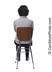 woman sitting on a chair with her back on white background