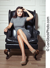 Woman sitting on a chair.