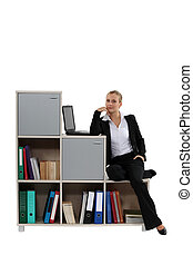 Woman sitting on a modern bookcase