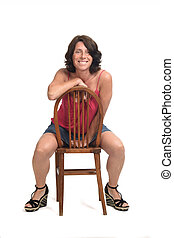 woman sitting on a rotated chair and looking at camera