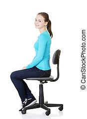 Woman sitting on a wheel chair.