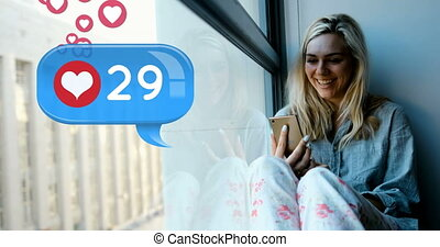 Woman sitting on a window sill typing on her phone 4k