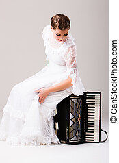 Woman sitting on accordion