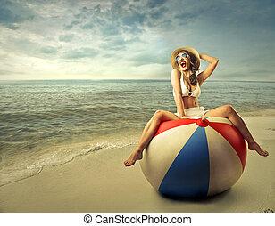 Woman sitting on ball