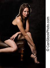 Woman sitting on black
