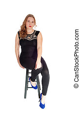 Woman sitting on chair in tights.