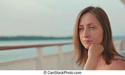 woman sitting on deck of cruise ship