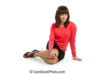 woman sitting on floor isolated on white background