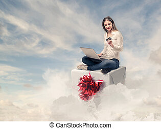 Woman sitting on gift