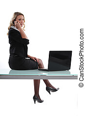 Woman sitting on her desk