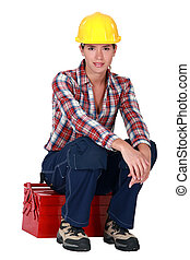 Woman sitting on her toolbox