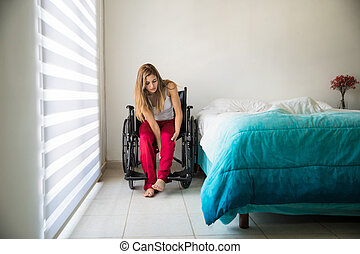 Woman sitting on her wheelchair