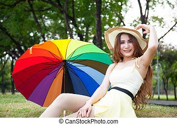 Woman sitting on lawn