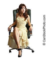 woman sitting on office armchair