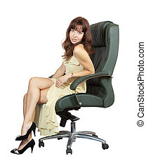 woman sitting on office armchair