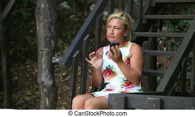 Woman sitting on park  and talking