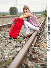 woman sitting on rail