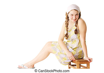 Woman sitting on small bench