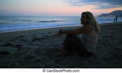 Woman sitting on the beach