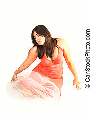 Woman sitting on the floor.
