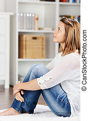 Woman sitting on the floor and thinking