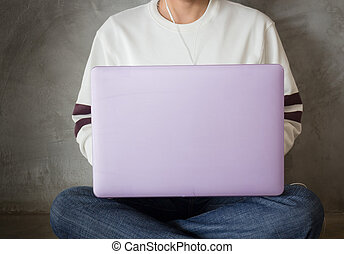 Woman sitting on the floor using laptop