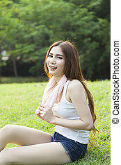 Woman sitting on the grass.