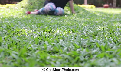 woman sitting on the grass with a phone in his hand