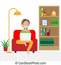 Woman sitting on the sofa working with laptop. Telecommuting