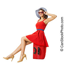 Woman sitting on vacation suitcase. Summer holiday travel. ...