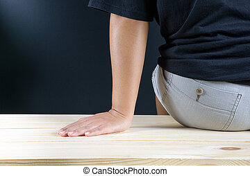 Woman sitting on wood floor