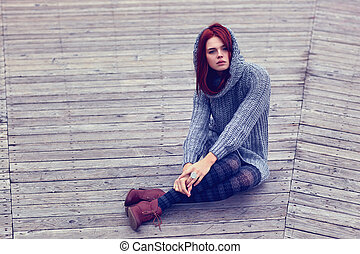 Woman sitting outdoors